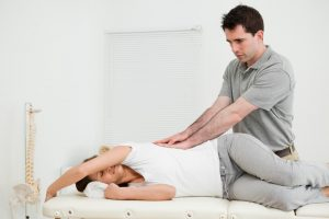 Lady having a Chiropractic session for back pain