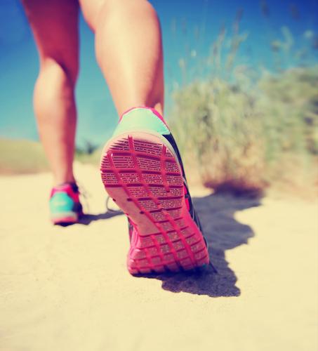 Running woman's legs