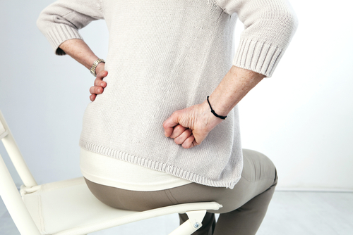 Woman holding hip in pain