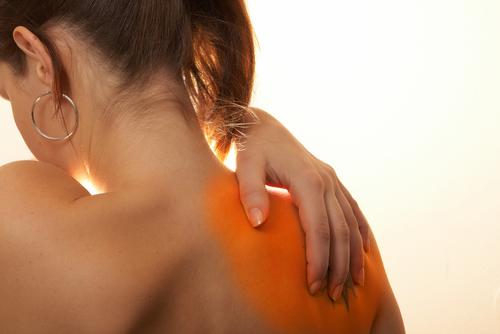 Woman Suffering Frozen Shoulder