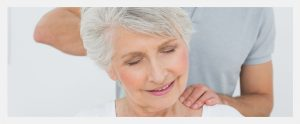 Elderly woman getting chiropractic care