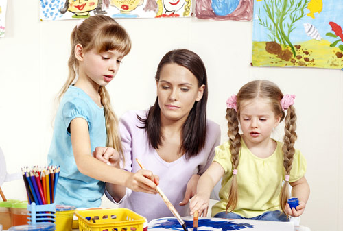 Children Painting with Their Mother