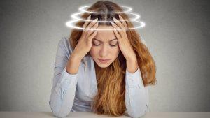 Woman suffering from Dizziness