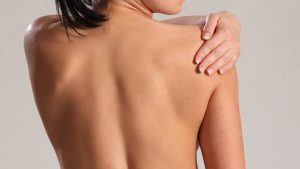 Young woman with frozen shoulder