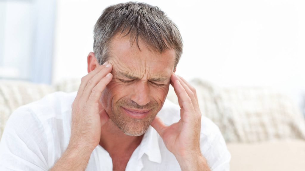 Man suffering from headaches