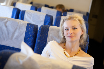 Woman On Airplan with Pillow Neck Support
