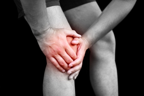 Man Suffering Severe Knee Pain