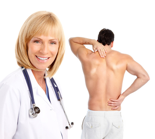 Man with Back Pain at Chiropractor's Office