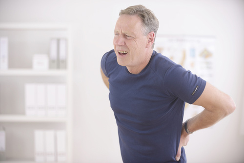 Older Gentleman Suffering Lower Back Pain