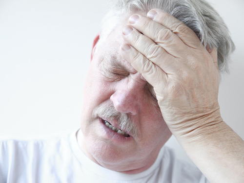 Older Man Suffering Vertigo Dizziness