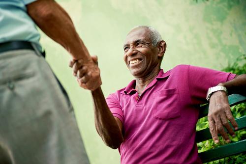 Older Men Shaking Hands