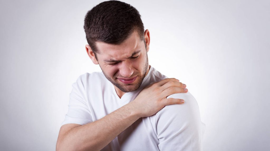 Man suffering with shoulder pain