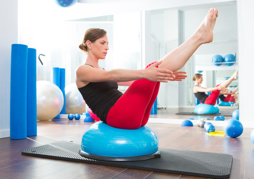 Woman Stretching on BOSU Ball