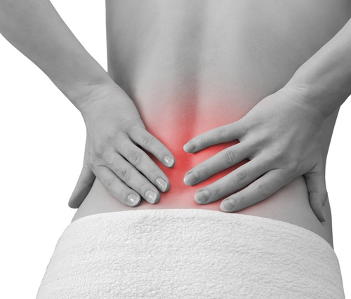 Woman with Throbbing Lower Back Pain
